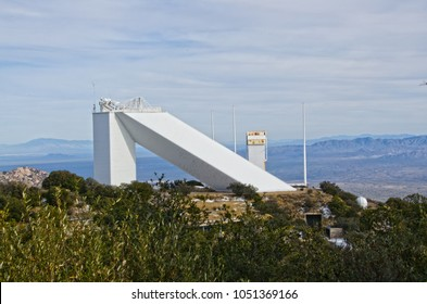 Kitt Peak is an astronomical observatory in the Sonoran Desert of Arizona on the Tohono O'odham Indian Reservation.  It has 23 obtical and 2 radio telescopes.