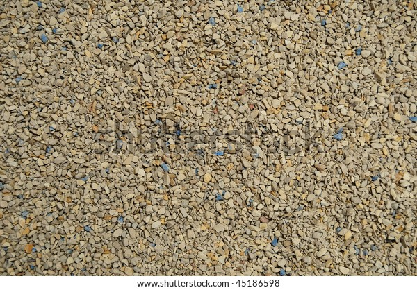 Kitty Litter Background Texture with clean new brown, gray, and blue rocks mixed in.