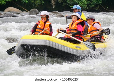 Kiulu Sabah Malaysia - Feb 25, 2018 : Group of adventurer doing white water rafting activity at Kiulu river Sabah Malaysian Borneo on Feb 25, 2018.The river is popular for its scenic nature view.