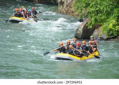 Kiulu Sabah Malaysia - June 7, 2015.Group of adventurer doing white water rafting activity at Kiulu river Sabah Malaysian Borneo on June 7, 2015.