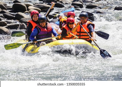 Kiulu Sabah Malaysia - Mar 26, 2019 : Group of adventurer doing white water rafting activity at Kiulu river Sabah Malaysian Borneo on Mar 26, 2019.The river is popular for its scenic nature view.