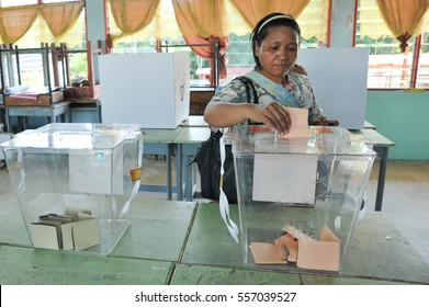 Kiulu Sabah Malaysia - May 5, 2013 : An unidentified Malaysian woman casts a vote during 13th Malaysian General Election on May 5, 2013 in Kiulu Sabah Malaysia.