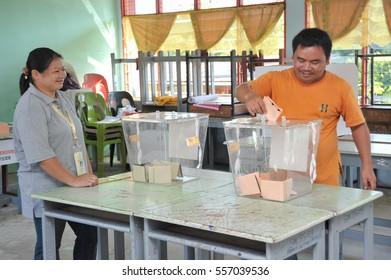 Kiulu Sabah Malaysia - May 5, 2013 : An unidentified Malaysian man casts a vote during 13th Malaysian General Election on May 5, 2013 in Kiulu Sabah Malaysia.