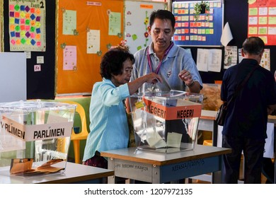 Kiulu Sabah Malaysia - May 9, 2018 : Malaysian senior citizen casts a vote during 14th Malaysia General Election in Kiulu Sabah Malaysia.