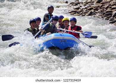 Kiulu Sabah Malaysia - Nov 4, 2018 : Group of adventurer doing white water rafting activity at Kiulu river Sabah Malaysian Borneo on Nov 4, 2018.The river is popular for its scenic nature view.
