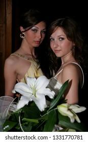 KIVERCI, Volyn / UKRAINE - June 27 2009: Unknown graduation girls with flowers posing near school
