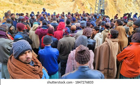 """Kiwai, Pakistan - OCTOBER 8, 2020: Chinese dam worker labour community protesting against the government's proposed labour reforms in a controversial """"jobs creation"""