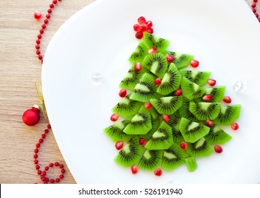 Kiwi Christmas tree - fun food idea for kids party or breakfast, New Year food background