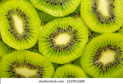 Kiwi closeup as background. Ripe kiwi fruit in the cut. Kiwi seed texture.