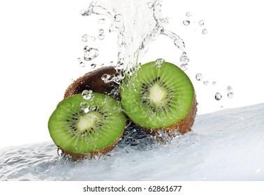 kiwi fruit being washed isolated on white