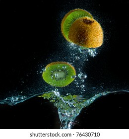 kiwi fruit splashing in the water