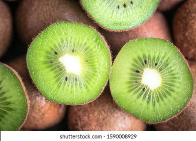 Kiwi fruit whole and sliced. Top view close-up.