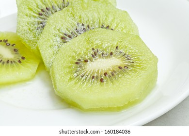 Kiwi fruits on white plate