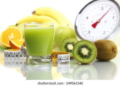 kiwi juice in glass, fruit tape meter scales diet food