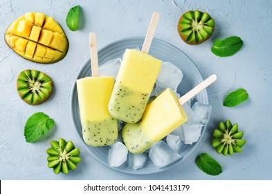 Kiwi mango ice cream with fruits and ices. toning. selective focus