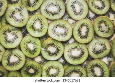 Kiwi slices background. Slices of ripe kiwi. Kiwi background.