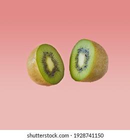 Kiwi slices on pastel pink background. Minimal fruit concept.
