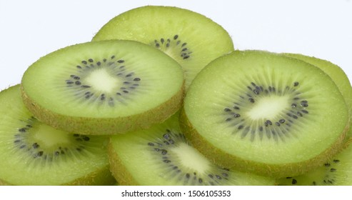 Kiwi slices on white background, healthy food concept.
