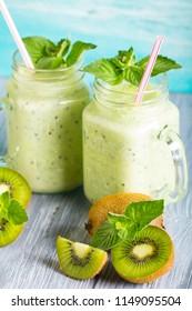 kiwi smoothies fresh vitamin cocktail wooden background