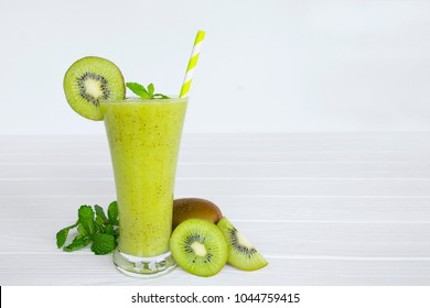 kiwi yogurt smoothies juice and kiwi fruit for breakfast in the morning  on white wood.