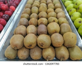 kiwis for sale in supermarket in the section of hortifruti, with blurred background