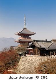 Kiyomizu Temple with tall pagoda tower in Kyoto Japan. Kiyomizu-dera is UNESCO World Heritage listed.