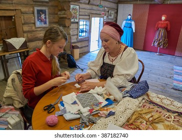KIZHI ISLAND, RUSSIA - AUGUST 2015: Teen girl is taking class of Russian Doll Making