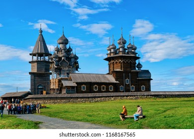Kizhi, Russia - June 12, 2015: Tourists at Kizhi Pogost with Transfiguration Church on Ladoga Lake in Karelia, Russia