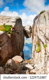 Kjeragbolten - famous landmark on Kjerag mountain, Norway. Summer landscape