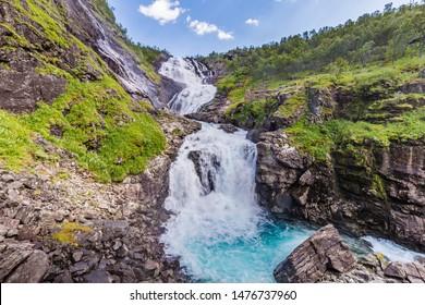 Kjosfossen waterfall along the most beautiful train journey Flamsbana between Flam and Myrdal in Aurland in Western Norway