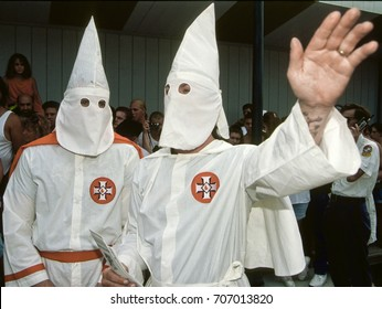 KKK rally and march on the boardwalk in Ocean City, Maryland,  4th July, 1992 A pair of hooded Klansmen wave to counter protesters during the march along the boardwalk of the resort town.