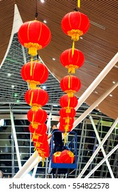 KL International Aiport 11th January 2017 ; A worker arranges Chinese new year decorations at Malaysia Airport