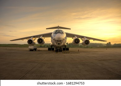 KL INTERNATIONAL AIRPORT, MALAYSIA 24th March 2020:A huge Cargo Plane Volga-Dnepr Airlines Ilyushin Il-76TD-90VD Parking on The Cargo Loading Bay with sunrise background.
