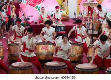 KL, MALAYSIA - 21 FEB 2016 : Teenagers performing the Chinese musical drums show at Pavilion shopping gallery, Kuala Lumpur Malaysia during auspicious monkey chinese new year 2016.