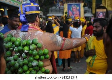 KL, MALAYSIA - 9 FEB 2017 : Thaipusam kavadi bearer bestow blessing to a hindu believer at Batu Cave temple, Kuala Lumpur Malaysia 2017.