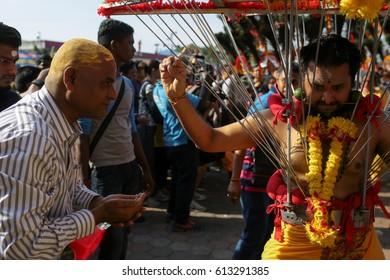KL, MALAYSIA - 9 FEB 2017 : Thaipusam kavadi bearer bestows blessing to a believer at Batu Cave temple, Kuala Lumpur Malaysia 2017.
