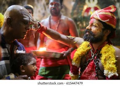 KL, MALAYSIA - 9 FEB 2017 : Thaipusam kavadi bearer bestows blessing to believer at Batu Cave temple, Kuala Lumpur Malaysia 2017.