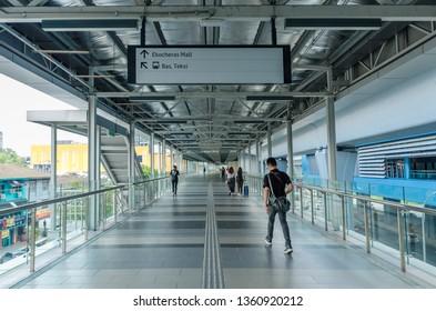 KL, Malaysia - April 5,2019 : A link bridge connects the Eko Cheras mall directly to the MRT Taman Mutiara station. People can seen walking through the bridge.