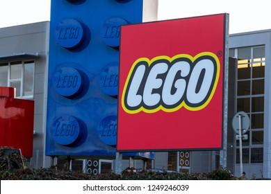KLADNO, CZECH REPUBLIC - DECEMBER 4 2018: Giant Lego bricks in front of the Lego Group company logo production plant on December 4, 2018 in Kladno, Czech Republic.
