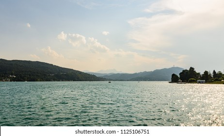 Klagenfurt, Carinthia - Austria - 19.07.2018 : Klagenfurt, Carinthia - Austria - 19.07.2018 : Worthersee view on lake and mountains in the far.