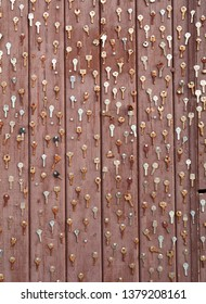 KLAIPEDA, LITHUANIA - 17 APRIL 2019: Plenty of old keys on the wooden wall. Residential facade, Market street. Klaipeda, Lithuania.