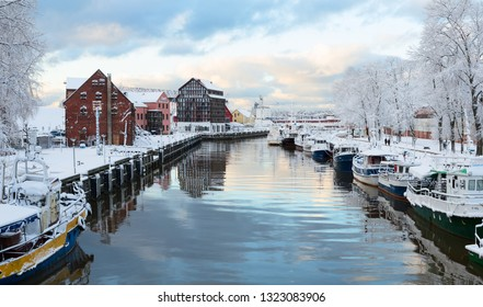 KLAIPEDA, LITHUANIA - 18 JANUARY 2019: Early morning on the main city quay. Danes river canal. Port of Klaipeda city, Lithuania.