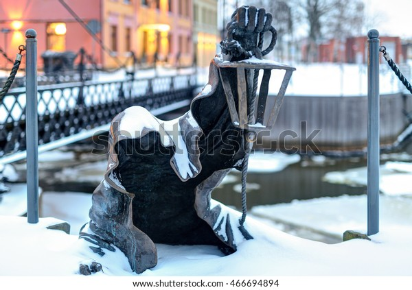 KLAIPEDA, LITHUANIA - 20 JANUARY 2016: Black Ghost bronzed sculpture. Danes river quay. Klaipeda Old Town residential district. Lithuania