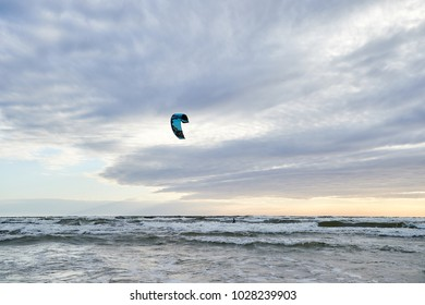 Klaipeda, Lithuania. August 04,2017. Kiteboarding is an on and above water sport combining aspects of wakeboarding, snowboarding, windsurfing, surfing, skateboarding and sailing into one extreme sport