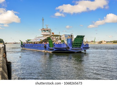 Klaipeda, Lithuania - August 20, 2017:  Big passenger barge and view on Klaipeda port in  Curonian Lagoon. View from The Curonian Spit on city port, Klaipeda Lithuania