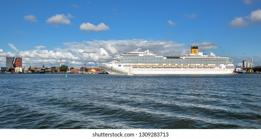 Klaipeda, Lithuania - August 20, 2017: Beautiful summer view on Klaipeda port and big white international cruise ship Costa Pacifica on Curonian Lagoon from The Curonian Spit, Klaipeda Lithuania.