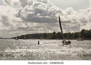 KLAIPEDA, LITHUANIA - SEPTEMBER 22, 2018: Small yachts are sailing in the waters of the Curonian Lagoon near the port of Klaipeda (former town name is Memel).