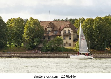 KLAIPEDA, LITHUANIA - SEPTEMBER 22, 2018: Small sail yacht are sailing in the waters of the Curonian Lagoon near the Klaipeda (former town name is Memel).