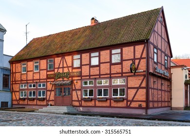 "KLAIPEDA TOWN, LITHUANIA - 30 APRIL 2015: ""Dziugas"" surio namai (eng. ""Dziugas"" cheese house) facade. Half-timbered house in the old town of Klaipeda city. Lithuania."