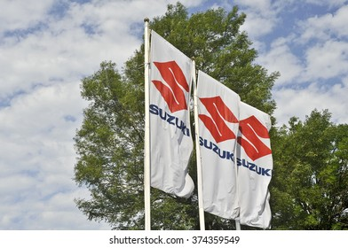 KLAIPEDA,LITHUANIA-JULY 08:flag of Suzuki on July 08,2015 in Klaipeda,Lithuania. Suzuki Motor Corporation is a Japanese multinational corporation.